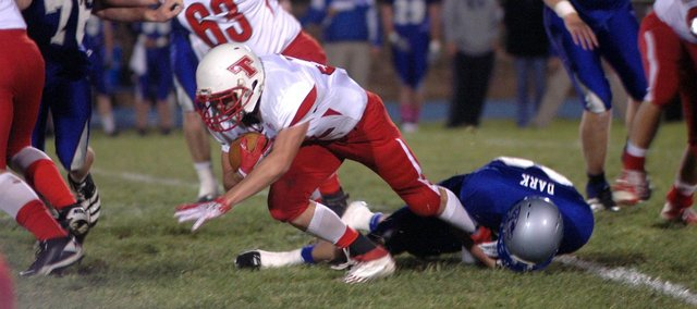 Jared Sommers fights for yardage in Tonganoxie's 30-0 loss at Perry-Lecompton.