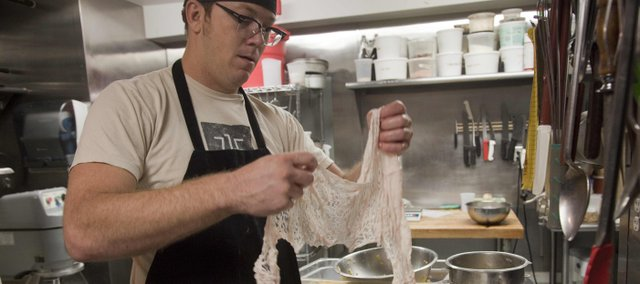Michael Beard, executive chef at 715 restaurant, 715 Mass. in Lawrence, prepares his fegalo appetizer. The dish, an occasional special at 715, features Italian-style pork liver sausage wrapped in caul fat — the fat that encases the pig's vital organs such as the heart and liver — and garnished with a laurel leaf.