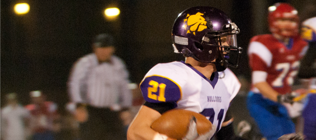 Drew Cerny returns an interception during McLouth's 51-6 win Friday at Oskaloosa.