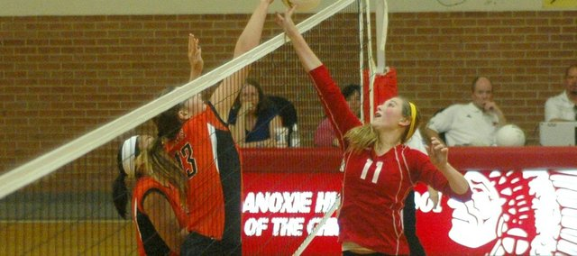 Tonganoxie's Lauren Jackson battles Bonner Springs' Mikaela Bennett for a ball at the net. The Chieftains fell to the Braves in five sets on Tuesday.