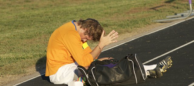 Baldwin senior goaltender Mason Bandre gathers his thoughts after minutes after the Bulldogs' lost, 1-0, Tuesday to De Soto in a match that decided the Frontier League title.