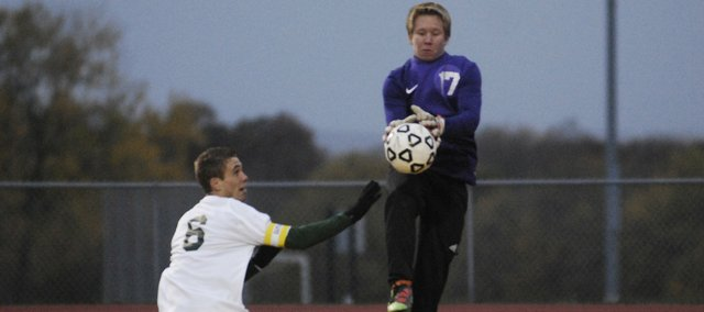 BSHS junior goalkeeper Dominic Salvino leaps for a save in front of BLHS senior Trey Kincheloe in a 0-0 tie on Thursday.