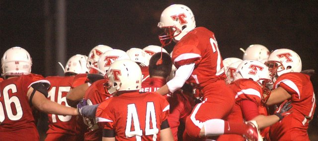 Players celebrate as time runs out in Tonganoxie High's 9-7 win against Jeff West on Friday at Beatty Field.