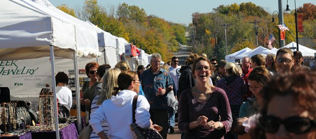 The crowd for the Maple Leaf Festival swelled Saturday shortly after the parade ended. A large crowd is expected with the mild, sunny weather.