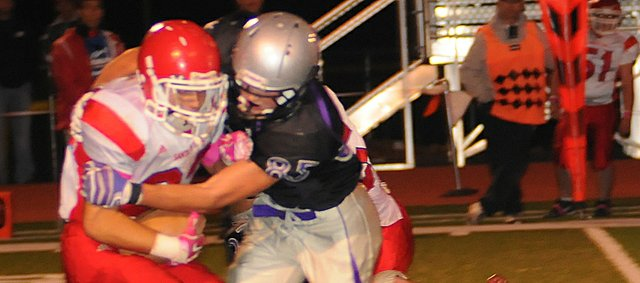 Bulldog junior Luke Fursman wraps up a Charger player for a loss Friday.