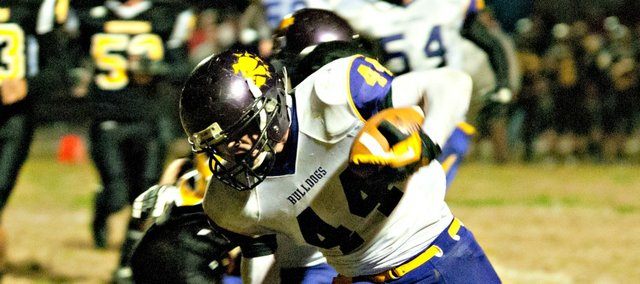 Dakota Cop fights for yardage in McLouth's 36-6 win Friday at Valley Falls.