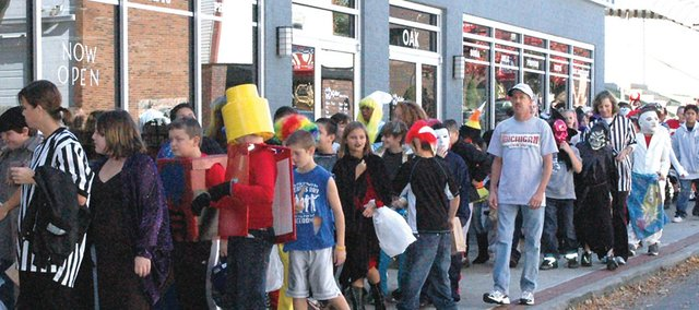 Bonner Springs Elementary School students trick-or-treat and parade through downtown Bonner Springs last year. Safe Kids Kansas is reminding trick-or-treaters of safety measures they need to take on Halloween.