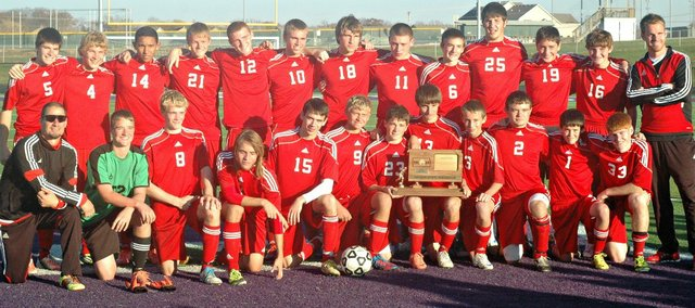 The Tonganoxie High soccer team poses with its state runner-up trophy Saturday at Piper High School.