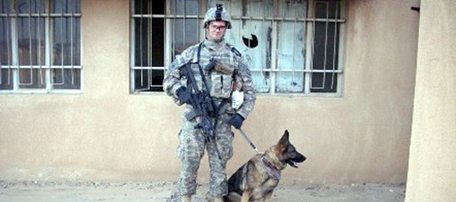 Joe Pate and his military working dog, Aida,  search polling locations in northern Iraq before the January 2009 elections.