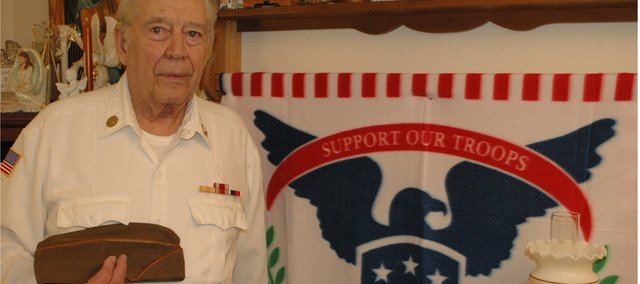 Gerry Daniel of Bonner Springs holds his cap, the only remaining piece of his uniform from his service during World War II.