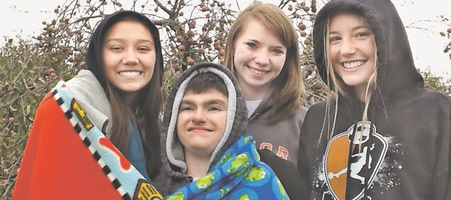 Pictured, from left: Mariah Seifert, Caeleb Otting, Nicole Hill and Gwen Barrett. The BSHS Friendship Club traveled to the Cider Hill Family Orchard, 3341 N. 139th Street, Kansas City, Kan., which donated its orchard for a day of picking apples and making s'mores over a bonfire.