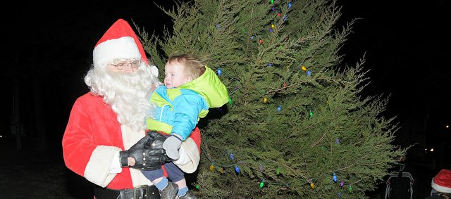 Santa Claus will find a better tree and a more colorful downtown when he arrives for the Dec. 8 Festival of Lights in Baldwin City.