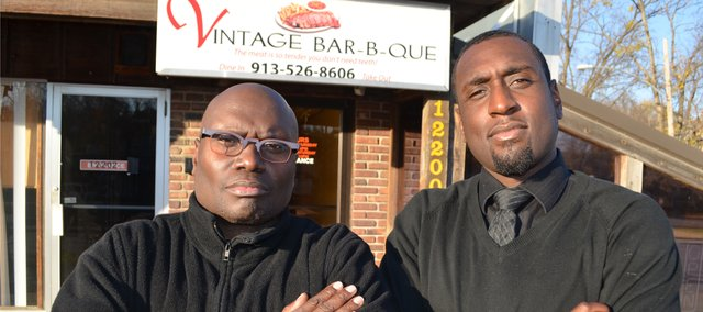 Vintage Bar-B-Que owner Johns Hawkins, left, is pictured outside the new establishment with his son, John Hawkins Jr.
