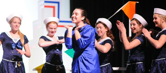 BHS senior Regan LaTessa as evangelist turned nightclub diva Reno Sweeney and her Angels vamp before the S.S. American sets sail in the musical Anything Goes.