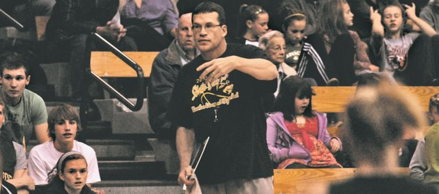 BLHS girls basketball coach Jason Tatkenhorst signals for a substitution on Friday during the Meet the Bobcats preseason scrimmage.