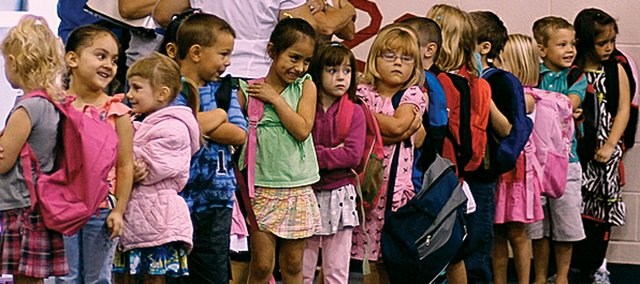 In this 2010 file photo, a new class of kindergartners lines up in the gym of Starside Elementary School before going to class for the first time. Next school year, De Soto school district will begin offering full-day, fee-based kindergarten as an option for parents.