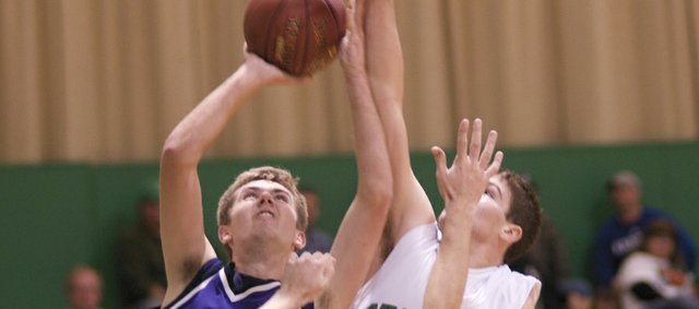 Baldwin senior Caleb Gaylord gets fouled under the basket Friday in Baldwin's 63-43 victory in its first game of the year at Jefferson County North. Gaylord lead the Bulldogs with 18 points.