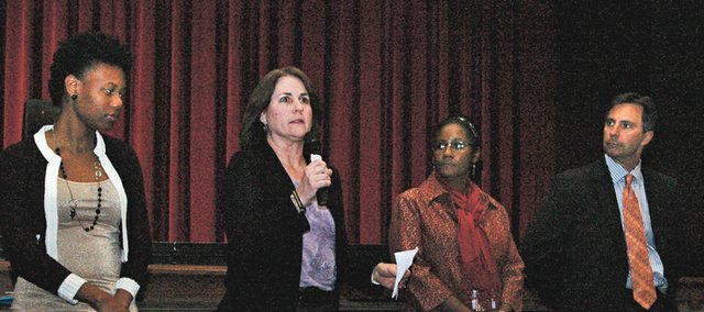 "Gwyn Heidrick, second from left, a social worker at Hocker Grove Middle School, participates in a panel discussion last Wednesday night following a screening of ""Race to Nowhere."" Other members of the panel, from left, were Catrina Bennett with Mental Health America of the Heartland; Ada Wallace, social worker at Crestview Elementary School; and Joe Karlin, executive director of the Tom Karlin Foundation, which works to prevent teen suicide and depression."