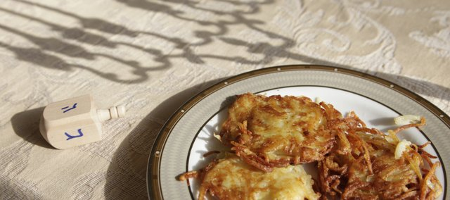 It's a Jewish tradition to prepare and eat traditional potato latkes — fried in oil — during Hanukkah. These were made by Nechama Tiechtel at Lawrence's Chabad Jewish Center.