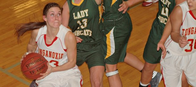 Jenny Whitledge scored 18 points and pulled down 11 rebounds in Tonganoxie High's win against Basehor-Linwood on Friday.