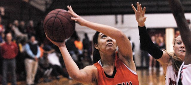 SMNW senior Anna King scored a team-high 14 points on Saturday, but the Cougars fell, 50-43, at Washburn Rural.