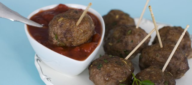 These cocktail meatballs, served with cranberry marinara sauce, embrace the combination of tangy, sweet and savory. The festive recipe is perfect as an appetizer for a New Year's Eve party or other holiday gathering.