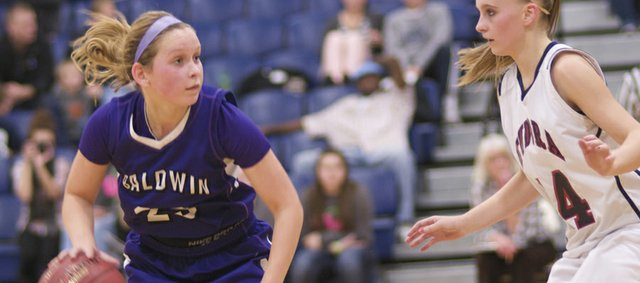 Baldwin senior Kailyn Smith runs the offense Tuesday against Eudora. The girls shut down the Cardinals&#39; offense to pick up a win on the road against its rival.