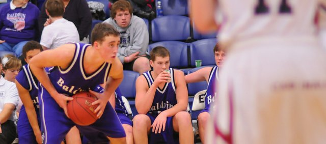Baldwin junior Luke Fursman surveys the floor in Tuesday's game against Eudora. Fursman scored 11 points in the victory and helped shut down Eudora's star in the road win against the Bulldogs' rival.