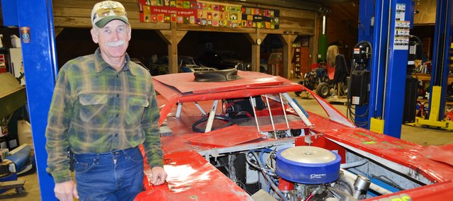 Don Marrs, shown with one of the cars he races at Lakeside Speedway, is buying the track.
