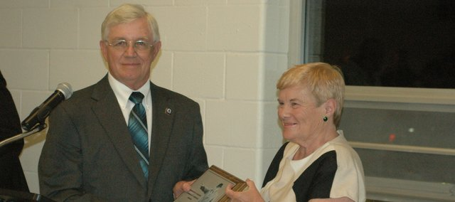 Bonner Springs Mayor Clausie Smith, left, presents the Marion Vaughn Community Service Award to Carol Geary at the 2012 Tiblow Days Mayor's Banquet. 2012 saw not only the retirement of Geary, after more than a decade as executive director for Vaughn-Trent Community Services, but also the announcement that Smith would not seek a sixth term as Bonner's mayor, a position he has filled for the last decade.