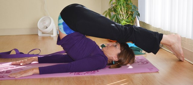 Theresa Ebel leads a class at her studio, Yoga Tree, 12212 Johnson Drive.