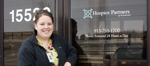 Clinical Supervisor Kelly Lopez hangs out at the new office for Hospice Partners of Kansas in Basehor.