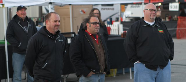 "Tonganoxie resident Tim Grant (left) of Truebud BBQ; Jeff ""Stretch"" Rumaner of Grinders, Kansas City, Mo.; and Rod Gray of Pellet Envy, Leawood, assemble in front of coolers during filming for the Kansas City episode of ""BBQ Pitmasters."" Grant's teammate Boyd Abts, Eudora, is behind him. The episode premiers at 8 p.m. Central time Sunday, Jan. 6, 2013."