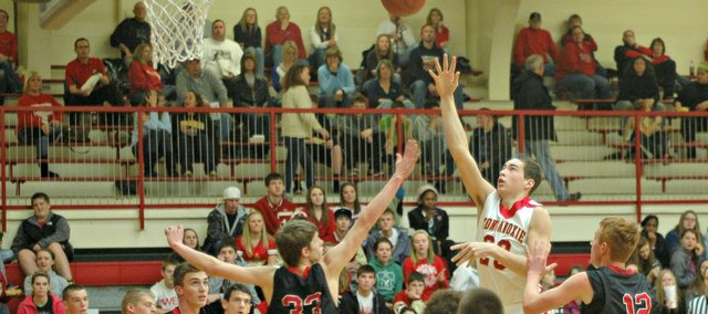 Ben Johnson was one of three players to reach double figures as Tonganoxie High won its third straight game.