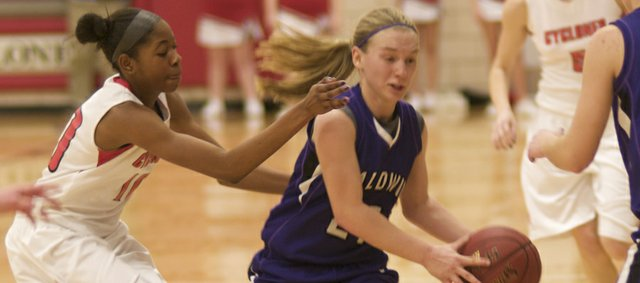 Baldwin Senior  guard Kaitlin Jorgensen breaks Ottawa pressure in the fourth quarter of the Bulldogs' victory Tuesday at Ottawa. The win coupled with a victory Friday against Louisburg improved the girls record to 3-1 in the Frontier League.