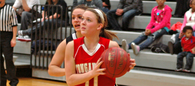 Emily Soetaert drives to the basket for two of her 13 points against Turner.