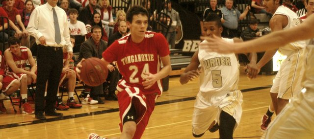 John Lean had a season-high 21 points, including a pair of clutch free throws with less than a second left in regulation, to propel Tonganoxie High past Turner.