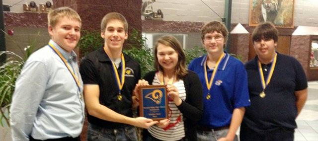 Bobcat Brainiacs team members, from left, Joe Levinson, Mitchell Mikinsky, Maddy Mikinsky, Jack McRaney and Nathan Lucas show off their gold medals and first-place plaque after winning the Pleasant Ridge meet Jan. 10.