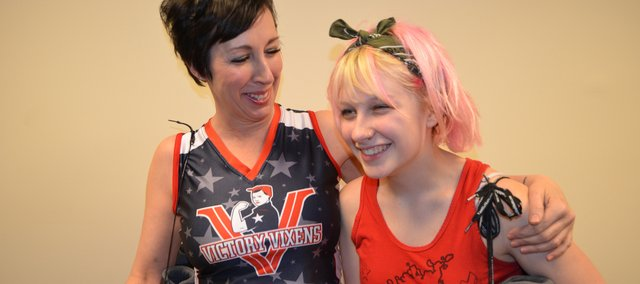 Mary Strafuss, left, a new member of the Kansas City Roller Warriors' Victory Vixens team, shares a laugh with her daughter Meara Roach, who participates in a junior roller derby program. Meara encouraged her mom to participate in the sport, which has helped the family rebound from a broken marriage.