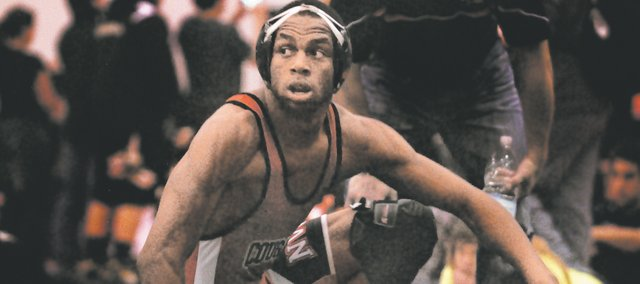 SMNW junior LaPhonso McKinnis is ranked No. 3 in Class 6A at 170 pounds in the latest Kansas Wrestling Coaches Association rankings. Along the way, he's won two tournaments and worked to earn back trust after mistakes from years past.