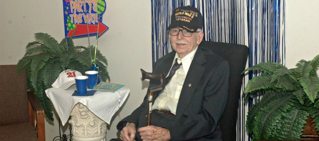 John Lenahan took center stage at an open house Sunday celebrating his 90th birthday. The afternoon gathering took place at the Tonganoxie VFW Post Home.