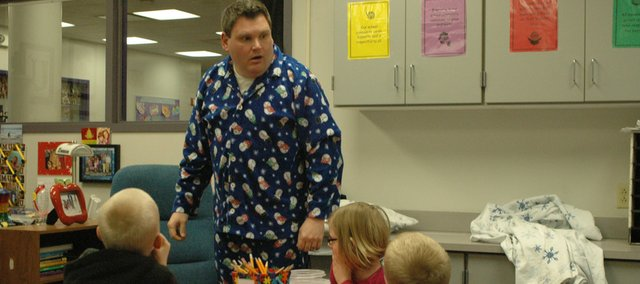 "Decked out in pajamas, first-grade teacher Jason Utlaut reacts with surprise when acting out a silent scene in which he wakes to find it has snowed overnight, and then goes ""outside"" to play in the snow. Utlaut used the theatrical scene to teach his students at Bonner Springs Elementary School to interpret a story using visual clues. Utlaut learned last week that he is one of 32 teachers in the state to earn the Horizon Award for first-year teachers."