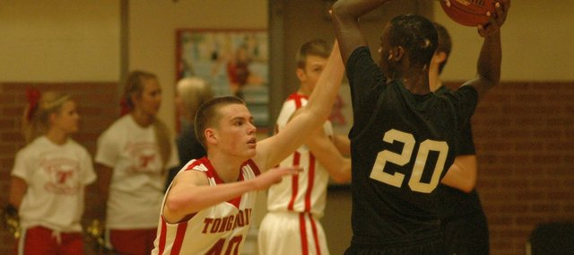 Jack Dale plays defense against Blue Valley Southwest's Dominique O'Connor in the Chieftains' 57-45 loss on Friday.