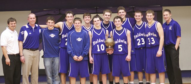 The Baldwin Bulldogs pose with the first-place trophy after winning the championship game of the Baldwin Invitational Tournament, 40-37, against Bonner Springs.