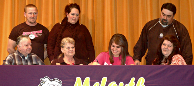 McLouth High senior Marissa Raya, front, second from right, will continue her softball career at Fort Scott Community College in 2013-14.
