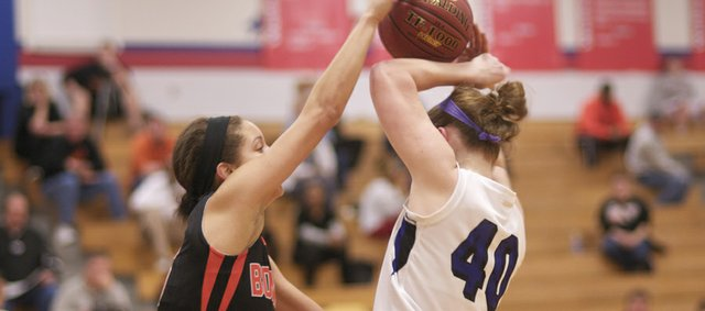 Bonner Spring freshman Julianne Jackson pressures Baldwin senior Kathy Kehl in the third quarter of championship game Saturday of the Wellsville Top Gun Tournament. Bonner Springs came from behind in the forth quarter to defeat Baldwin, 41-40.