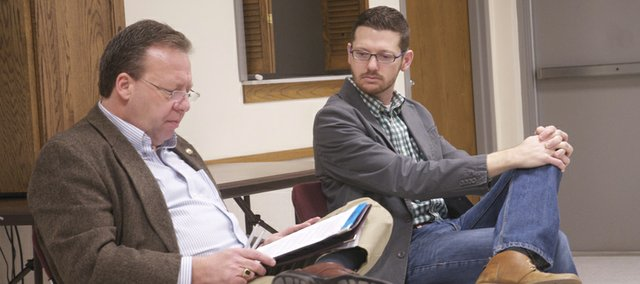 Sen. Tom Holland, left, and Rep. John Wilson discuss elements of Gov. Sam Brownback's two-year budget Saturday at a town hall meeting in the Baldwin City Public Library.