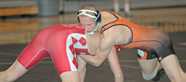 Aaron Puckett was one of three Bonner Springs wrestlers to record pins Thursday, but the Braves fell to Tonganoxie, 34-27.