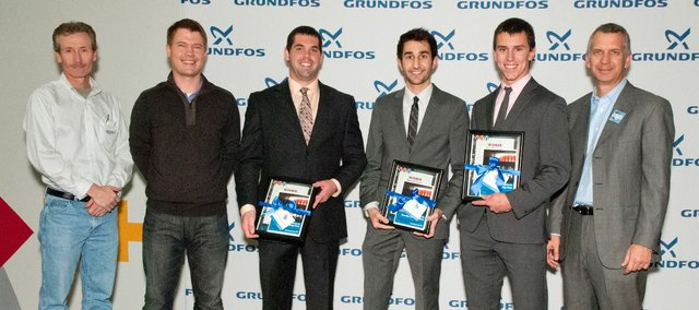 KU student Cole Bittel, second from right, stands with his teammates and Grundfos Challenge judges after winning the U.S. competition. The KU team advances to the international competition in Denmark in April.
