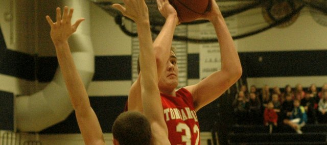 Eric McPherson shoots over Mill Valley's Patrick Muldoon in the Chieftains' 70-45 loss on Friday.